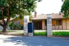 Home with wrought iron fences in Green Valley