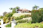 Stunning custom home with large spacious rooms is located in private Lomas Verdes Estates
