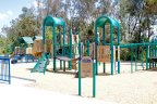 Residents of Rancho Arbolitos Community enjoy access to children play area near the residential area