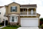 Two story home with balcony attached to bedroom in 4S Ranch Neighborhood in Rancho Bernardo California