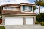 Two Story house with yellow florals beside driveway is located in Bernardo Point
