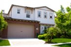 Gorgeous two car garage single family home with lush green lawn is located in Arabella Community in San Diego California
