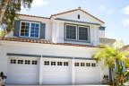 White stunning house with spacious room plan resides in Ashley Falls Community in San Diego California