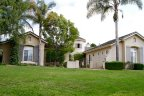 Gorgeous Villa home with lush green lawn is located in private Bel Etage Neighborhood