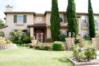 Two Story home with professionally manicured lawn resides in Bel Etage Neighborhood