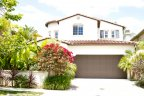 House with lush greens and floral plants is located in Bordeaux Community San Diego California