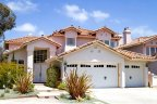 Beautiful three car garage home of three bedrooms resides in Cantamar Community