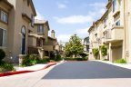 Residential streets of the Crest at Del Mar Townhomes neighborhood are wide and clear for spacious roomy parking.