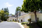 Condominium with two and three car garage resides in  Del Mar Highlands Community in San Diego California