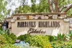 Gorgeous Fairbanks Highlands Estates Sign in midst of lush green plants