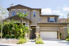 Beautiful home with two car garage and modest front lawn resides in Montellano San Diego