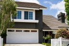 Two story home with dark paint and white trim stands out nicely in Penasquitos Estates