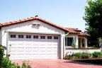 This home in Plumosa Park has a stained concrete driveway