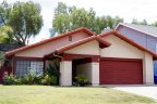 Single story home with modest front lawn is part of friendly Rancho Penasquitos San Diego
