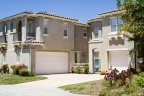 House with three car garage and cozy rooms is part of Seabreeze Community in San Diego California
