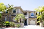 Traditional Home with brick design elements are located in private Seabreeze Neighborhood