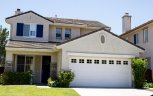 Gorgeous two story house with modest well maintained lawn resides in Torrey Hills