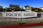 The Pacific Sands community marquee sits in the center of the street