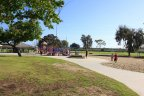 A large sandy playground with jungle gym at Seabury