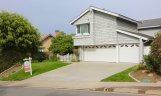 Gray two story home front in the community of Aliso Place Laguna Hills