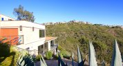 View from modern home looking out over hillside in Arch Beach heights Laguna Beach