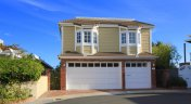 front exterior of cape cod style home in Balboa Coves, Newport Beach CA