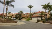 Street and fronts to homes in Belle Maison, Laguna Niguel CA