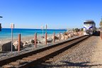 The amtrak train runs alongside the ocean at Capistrano Beach