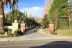 A Long winding driveway leads to a custom estate home in Capistrano Royale