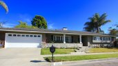 Front exterior to single story ranch home in Cherry Lake, Newport Beach CA