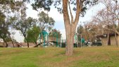 A view looking at a park and jungle gym in the community of Del Cerro in Costa Mesa