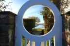 View through gate toward bay and water