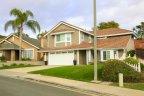 Tan two story home exterior in Stratford Ridge, Laguna Hills CA
