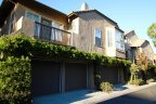 Exterior and driveway area to townhomes in The Summit Newport Coast CA
