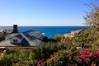 Looking over two custom homes at ocean from Three Arch Bay Laguna Beach