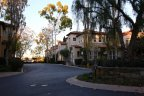 Roundabout and street view of townhomes in Trovare Newport Coast CA